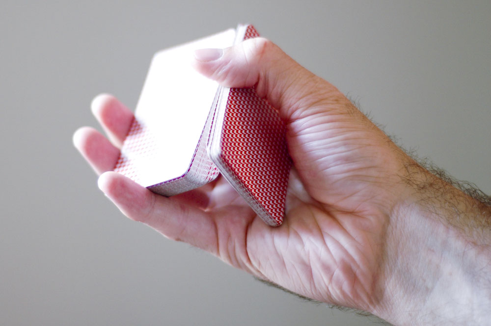 Cut a deck of cards with one hand