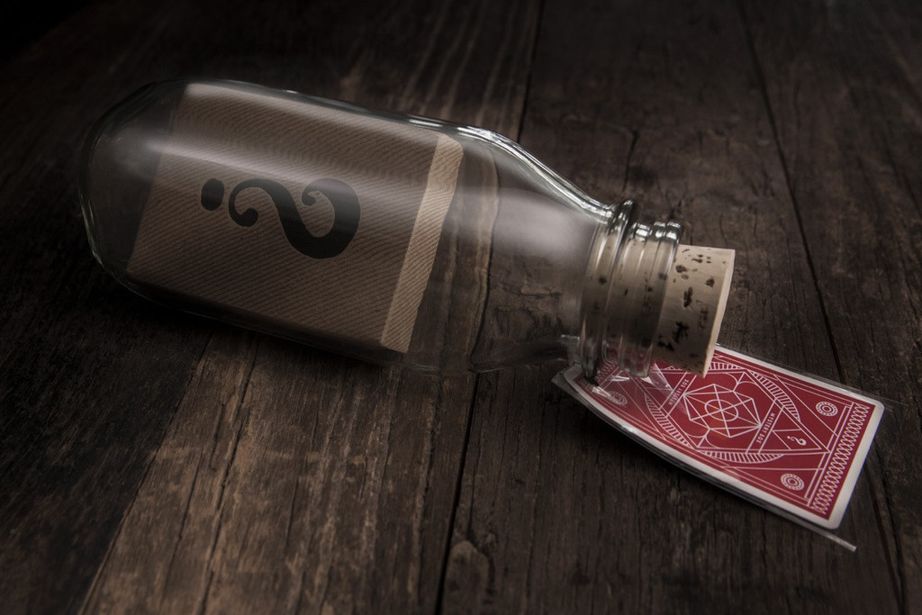 Deck of cards in a bottle