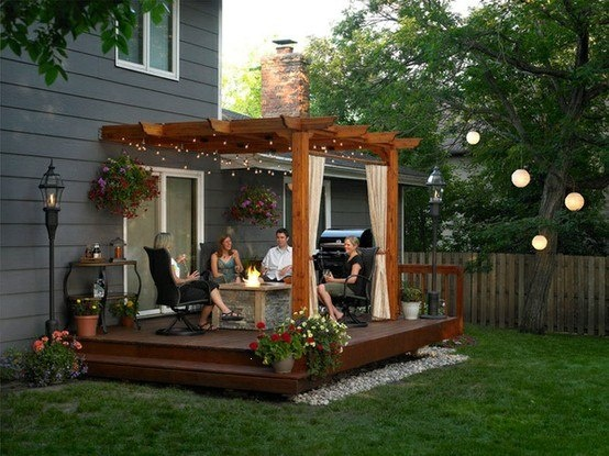 Deck with pergola attached to house
