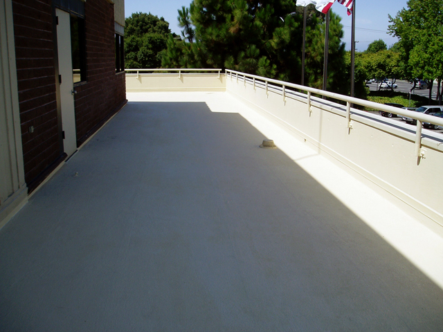 Elastomeric deck coating over plywood