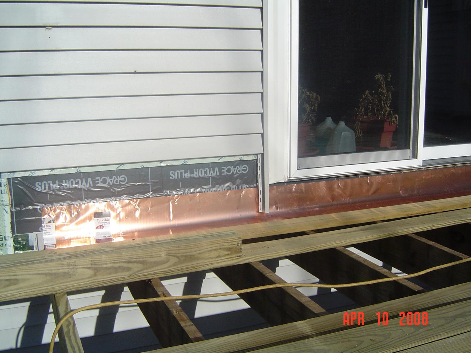 Flashing deck ledger board vinyl siding