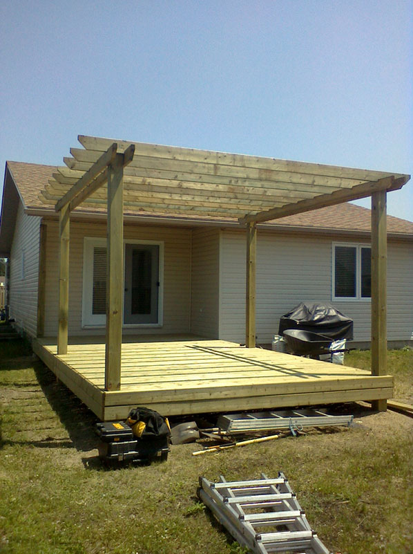 Ground level deck with pergola
