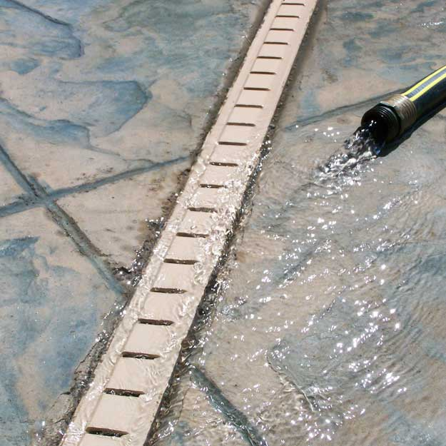 Pool deck drain installation