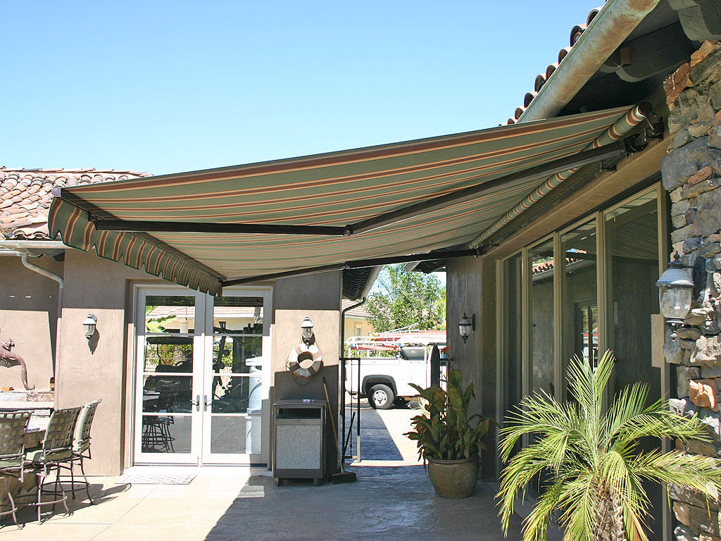 Retractable deck and patio awning