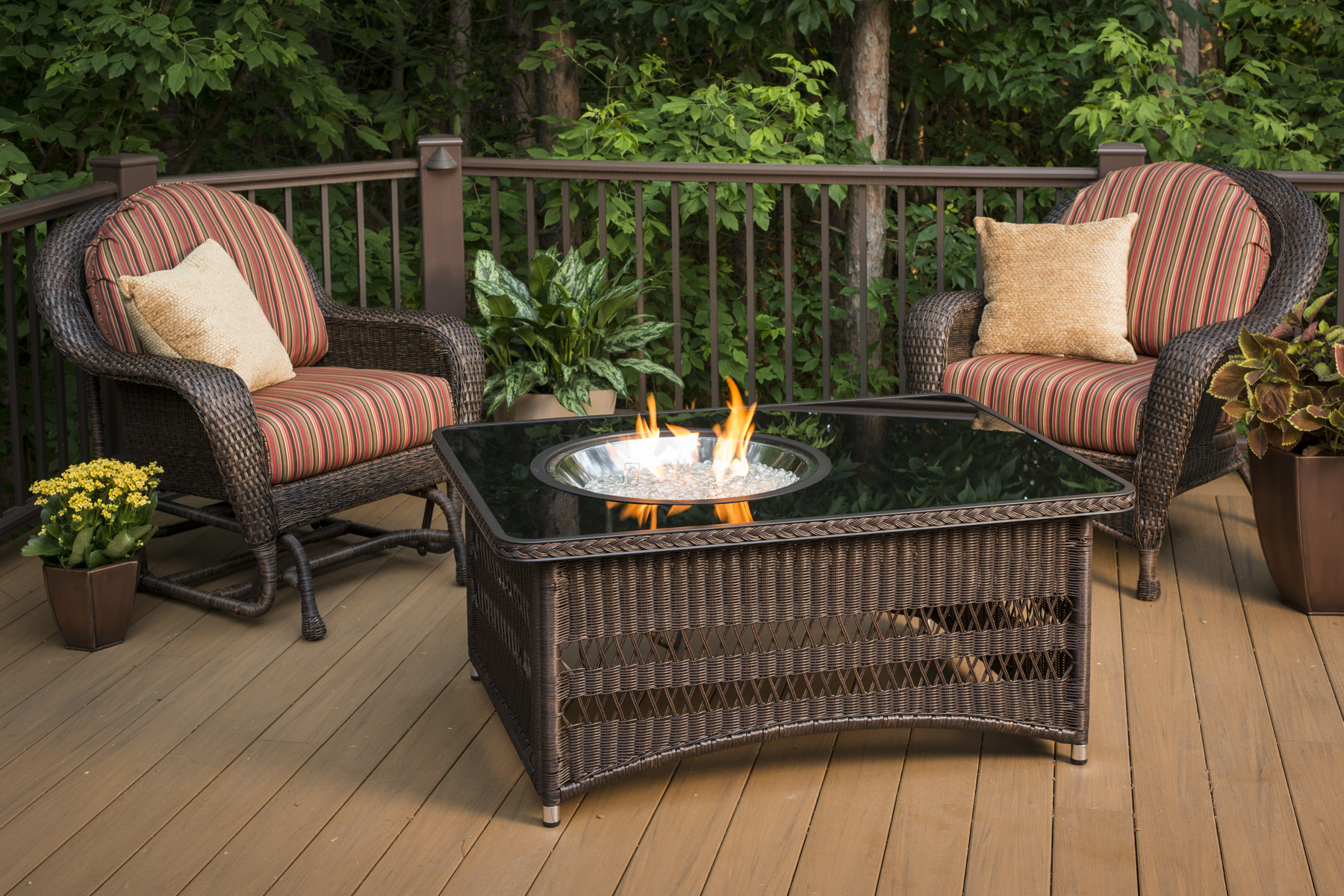 fire pit table on wood deck